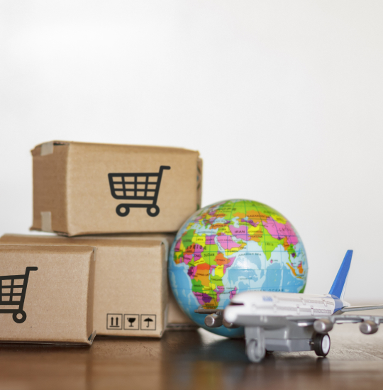 Delivery packages next to a globe.
